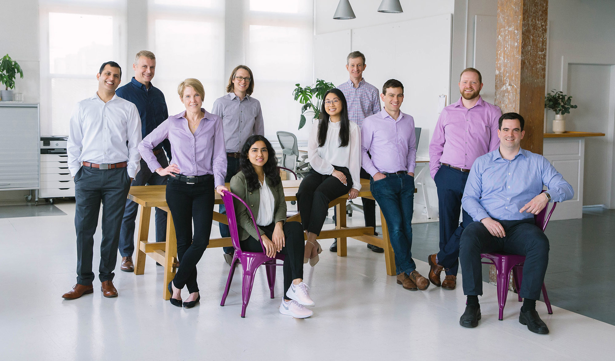 Mythic Therapeutics team in a white office with purple chairs